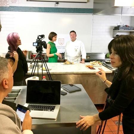 Director and producer Melinda Martinez speaks to producer Tony Monte while Sibylle Eschapasse and chef Olivier de Saint Martin prep for their segment. (Karen Dumonet)