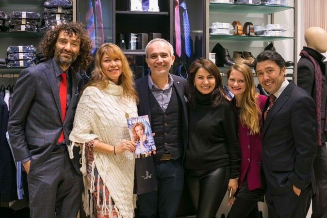 SAYKI owner Hatem Sayki (3rd from L) along with Talent in Motion magazine publisher A. Brooks, (2nd from L) and staff members of SAYKI, at the grand opening and holiday cocktail event at their first store in New York on Dec. 15, 2016. (Benjamin Chasteen/Epoch Times)