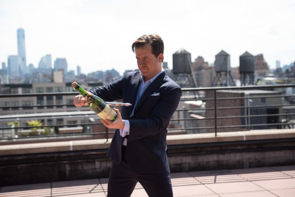 """Oldman gets ready to saber a bottle of bubbly. The tiny bubbles in fine sparklers create what Oldman calls Champagne's """"cashmere caress"""": a blanket of tightly knit bubbles that creates a cohesive, creamy texture in your mouth. (Jiyang Chen)"""