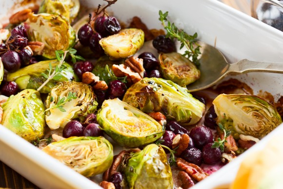 Roasted brussels sprouts with grapes, nuts and balsamic vinegar (sarsmis/shutterstock)