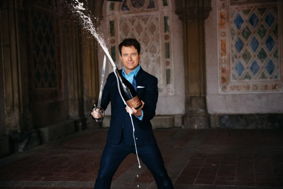 If there's an ultimate way to open a bottle of bubbly, this is it. Mark Oldman sabered over 30 bottles in Central Park last spring for a photo shoot for his book cover. When he gave the sabered bottles away to passersby, half were suspicious, and half were delighted.