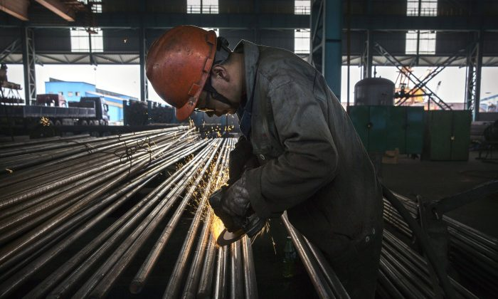 A worker in Changzhou, China's Jiangsu Province, on May 13, 2016. China is the largest provider of excess steel capacity in the world, stated the Commerce Department report. (Kevin Frayer/Getty Images)
