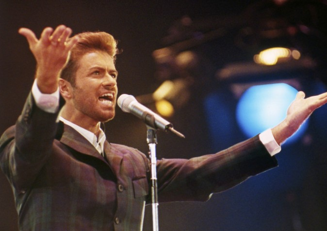 "In this Dec. 2, 1993 file photo, George Michael performs at ""Concert of Hope"" to mark World AIDS Day at London's Wembley Arena. According to a publicist on Dec. 25, 2016, the singer has died at the age of 53. (AP Photo/Gill Allen)"