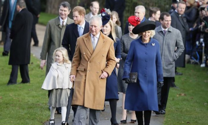 Britain's Prince Charles and Camilla, The Duchess of Cornwall lead other members of the Royal family as they arrive to attend a Christmas day church service in Sandringham, England, Sunday, Dec. 25, 2016. A heavy cold is keeping Queen Elizabeth II from attending the traditional Christmas morning church service near her Sandringham estate. (AP Photo/Kirsty Wigglesworth)