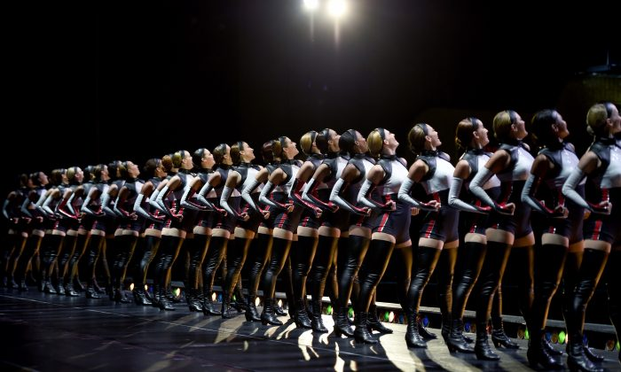"""The Radio City Rockettes perform """"Welcome to New York"""" in the 2016 New York Spectacular at Radio City Music Hall  in New York on July 6, 2016. (TIMOTHY A. CLARY/AFP/Getty Images)"""