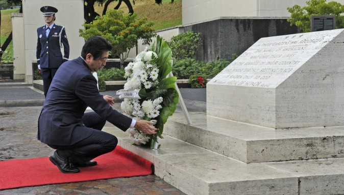 Japanese Prime Minister Shinzo Abe visits the National Memorial Cemetery of the Pacific to place a wreath at the Honolulu Memorial, in Honolulu on Dec. 26, 2016. (Bruce Asato/The Star-Advertiser via AP)