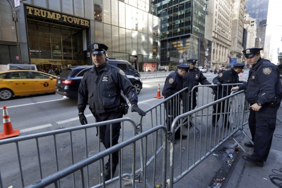 New York City Police adjust barricades across the street from Trump Tower on Fifth Avenue, in New York, Friday, Nov. 11, 2016.  Trump's presidential victory has increasingly turned the streets around his Trump Tower penthouse home into a hardened, national security location.  (AP Photo/Richard Drew)