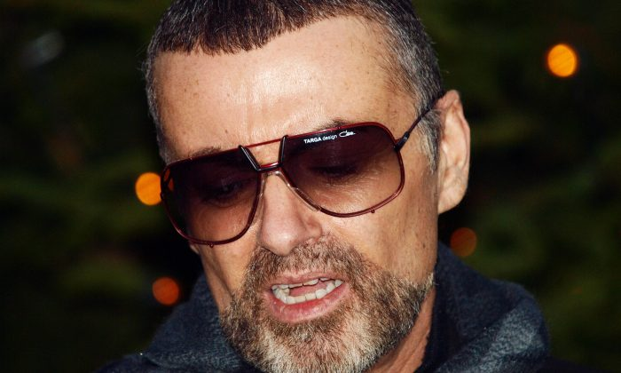British singer George Michael talks about his illness outside his home in Hampstead in London on Dec. 23, 2011. George Michael fought back tears as the British singer admitted that he had been at death's door after contracting a case of severe pneumonia while on tour in Austria. (MAX NASH/AFP/Getty Images)
