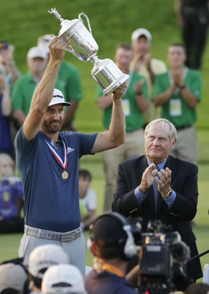 Dustin Johnson made it a clean sweep of the tour's biggest honors that are named after its most prominent players. (AP Photo/Gene J. Puskar)