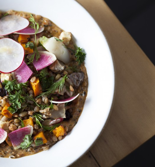 At Loring Place in New York City, chef Dan Kluger makes a grains salad with freekeh, warthog (a winter wheat variety), emmer (farro), smoked chili aioli, fall vegetables, and lemon. (Aliza Eliazarov)
