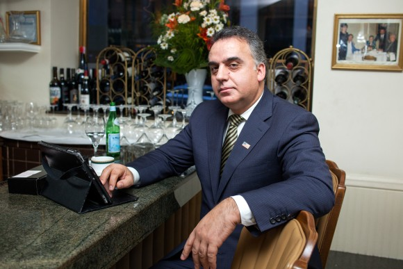 John Goci, owner of Italian restaurant il Tinello, in his restaurant on 56th St. in Manhattan on Dec. 27, 2016. His restaurant lost 20-30 percent of business due to security measures at the nearby Trump Tower, he said. (Petr Svab/Epoch Times)