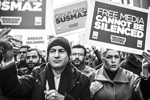 Journalists shout slogans and hold placards on January 10, 2016 during a march marking Journalism Day on Istiklal avenue in Istanbul as they protest against the imprisonment of journalists. (OZAN KOSE/AFP/Getty Images)