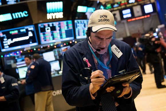A trader wearing a 'Dow 20,000' hat works on the floor of the New York Stock Exchange (NYSE), Dec. 13, 2016 in New York City. The Dow Jones Industrial Average was up over 100 points again on Tuesday as it continues to approach the 20,000 mark. (Drew Angerer/Getty Images)