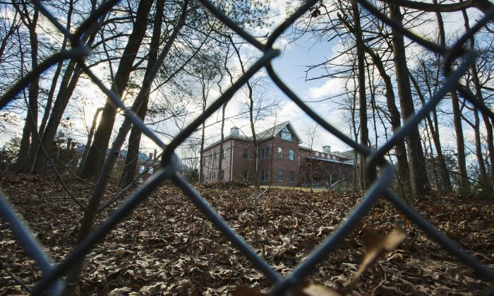 A fence encloses an estate in the village of Upper Brookville in the town of Oyster Bay, N.Y., on Long Island on Dec. 30, 2016. On Friday, the Obama administration closed this compound for Russian diplomats, in retaliation for spying and cyber-meddling in the U.S. presidential election. (AP Photo/Alexander F. Yuan)