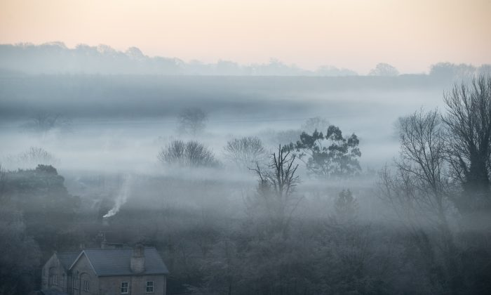 Early morning fog and mist lingers as the sun rises over the village of Kilmersdon, England, on Dec. 29, 2016. (Matt Cardy/Getty Images)