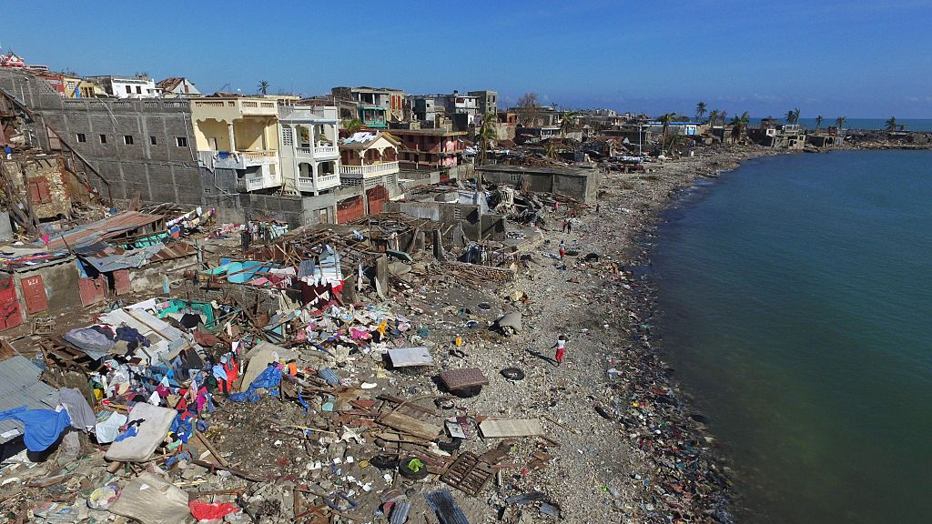 The areas of Jeremie, Haiti, destroyed by Hurricane Matthew are seen from the air on October 8, 2016.  The full scale of the devastation in hurricane-hit rural Haiti became clear as the death toll surged over 400, three days after Hurricane Matthew leveled huge swaths of the country's south. / AFP / Nicolas GARCIA        (Photo credit should read NICOLAS GARCIA/AFP/Getty Images)