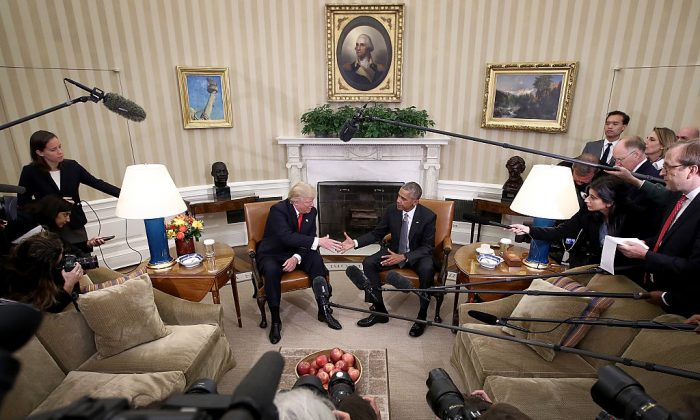 First Meeting: President Barack Obama shakes hands with President-elect Donald Trump following their first meeting since the election at the Oval Office in the White House on Nov. 10. (Win McNamee/Getty Images)