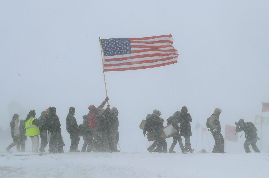 "Despite blizzard conditions, military veterans march in support of the ""water protectors"" at Oceti Sakowin Camp on the edge of the Standing Rock Sioux Reservation on December 5, 2016 outside Cannon Ball, North Dakota. (Scott Olson/Getty Images)"