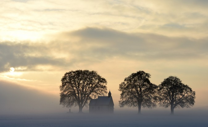 Fog surrounds a small church near the Bavarian village Apfeltrach, southern Germany, on Jan. 3, 2017. (Christof Stache/AFP/Getty Images)