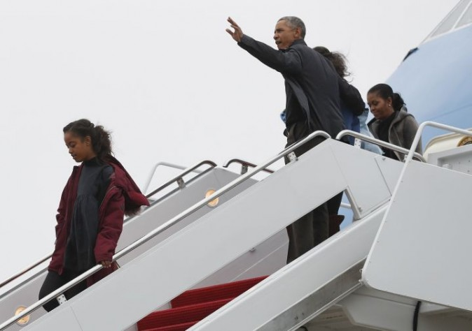 President Barack Obama, first lady Michelle Obama and their daughters Malia, left, and Sasha, right, arrive on Air Force One, Monday, Jan. 2, 2017, in Andrews Air Force Base, Md., en route to Washington as they return from their annual vacation in Hawaii. (AP Photo/Carolyn Kaster)
