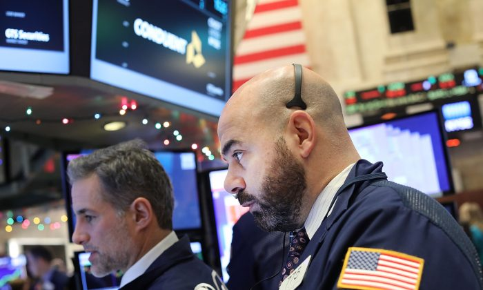 Traders work on the floor of the New York Stock Exchange on Jan. 3, the first trading day of 2017. Analysts see another year of gains for the S&P 500. (Spencer Platt/Getty Images)