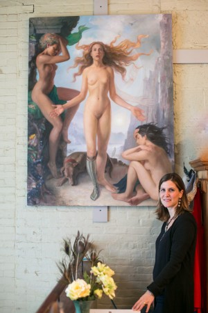 """Artist Patricia Watwood with her painting titled """"The Sixth Extinction,"""" 2015, oil on linen, 67 inches by 51 inches, in her home studio in Brooklyn, New York, on Dec. 14, 2016. (Benjamin Chasteen/The Epoch Times)"""