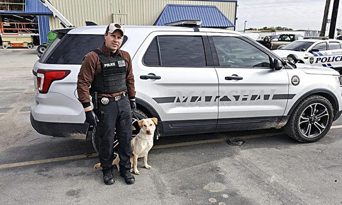 K-9 Duke and his handler.(Courtesy of Brad Croft)