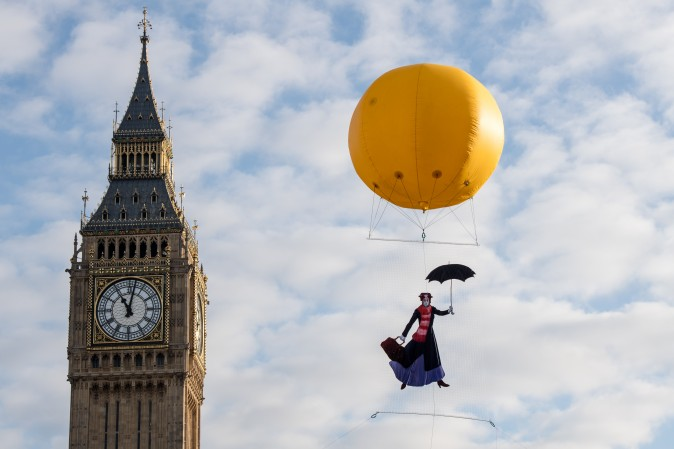 Greenpeace activists float a picture of Mary Poppins wearing a gas mask to highlight that London has breached its annual air pollution limit for 2017 in just five days in front of the Houses of Parliament in London on Jan. 6, 2017. (Chris J Ratcliffe/Getty Images)