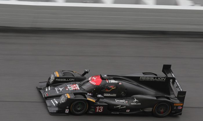 Neel Jani guides the #13 Rebellion Racing Orca-Gibson onto the banking at Daytona International Speedway Saturday, Jan.7, during Day Two of the 2017 Roar Before the Rolex 24. (Chris Jasurek/Epoch Times)
