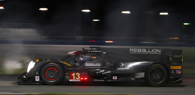 Nick Heidfeld takes a turn behind the wheel of the #13 Rebellion Oreca-Gibson, piercing a cloud of tire smoke during night practice at the 2017 Roar Before the Rolex 24. (Chris Jasurek/Epoch Times)