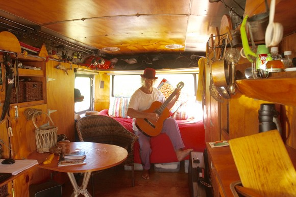 Meeting other RV'ers on the road in New Zealand: Keith Levy, storyteller and social commentator known as the Roaming Rhymester. This travelling artist lives in his large silver Bedford house bus full time. His home features beautiful and spacious wooden interiors. (Gina Nilsen /Epoch Times)