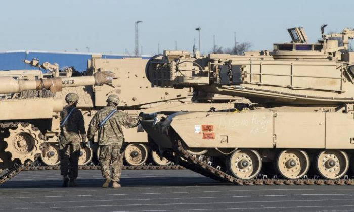 U.S. Tanks were unloaded  in Bremerhaven, northern Germany, Friday Jan. 6, 2017.  Ships loaded with U.S. tanks, self-propelled howitzers and hundreds of other fighting vehicles have arrived in the  northern German port en route to Eastern Europe to bolster NATO's deterrence to possible Russian aggression. (Ingo Wagner/dpa via AP)