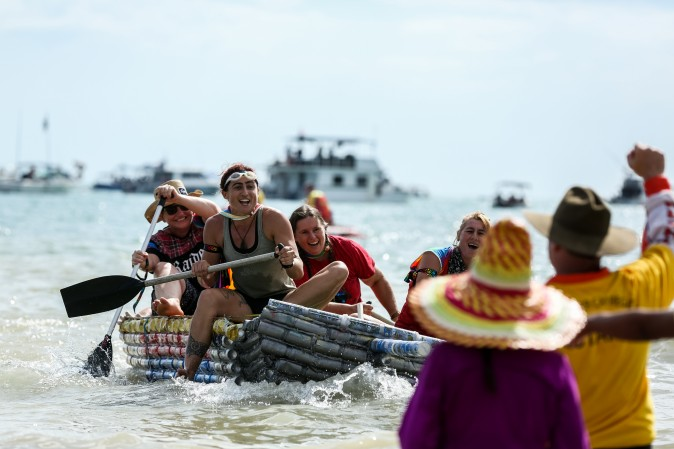 Rosie's boat leads the Beer Can Boat Race during the Darwin Beer Can Regatta at Mindil Beach in Darwin, Australia, on July 9, 2017. The annual event first started in 1974 as a way to clean up beer cans littering local streets. The all-day event includes boat races alongside thong throwing and sandcastle competitions. (Helen Orr/Getty Images)