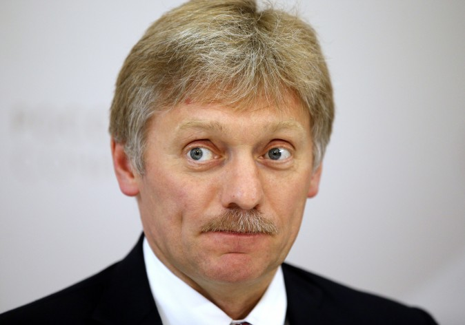 Russian President Vladimir Putin's press secretary Dmitry Peskov listens for a question during his news conference at the ASEAN Russia summit, in the Black Sea resort of Sochi, Russia, in this file photo. (AP Photo/Alexander Zemlianichenko)