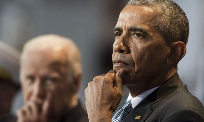 Then-President Barack Obama sits alongside then-Vice President Joe Biden at Joint Base Myers-Henderson Hall in Arlington, VA, on Jan. 4, 2017. (SAUL LOEB/AFP/Getty Images)