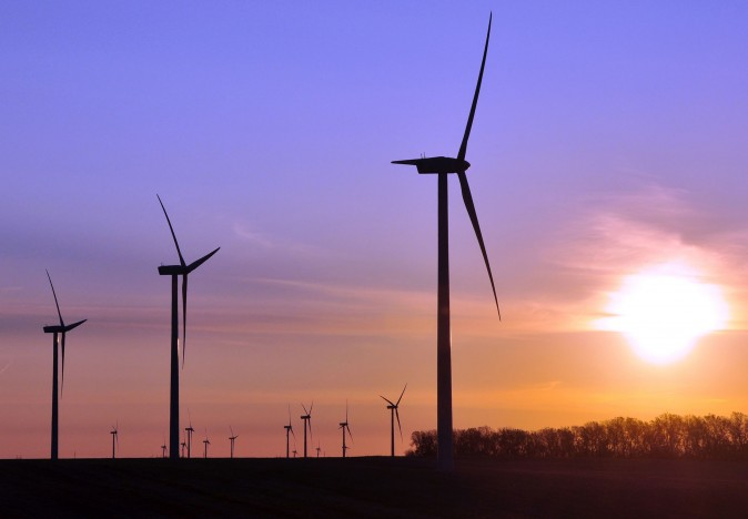 Turbines spin as the sun rises at a wind farm near Toronto, S.D., in 2011.  (AP Photo/Dirk Lammers,)