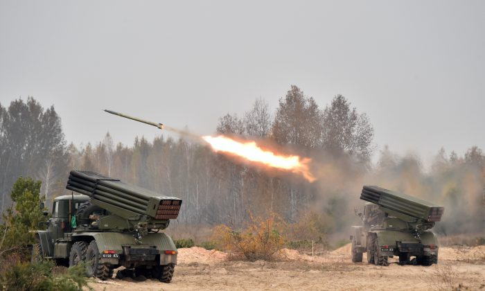 Ukrainian 122 mm MLRS BM-21 Grad fires rocket during a military exercise at a shooting range  close to Devichiki in the Kiev region on Oct. 28, 2016. (GENYA SAVILOV/AFP/Getty Images)