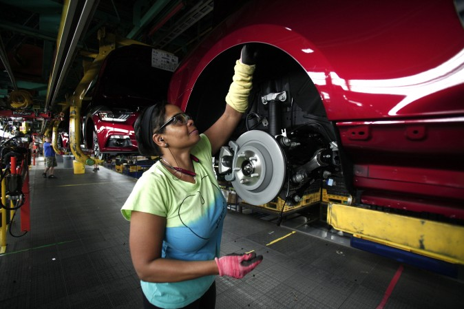Ford Mustangs go through an assembly line at the Ford Flat Rock Assembly Plant  in Flat Rock, Mich., on Aug. 20, 2015. (Bill Pugliano/Getty Images)