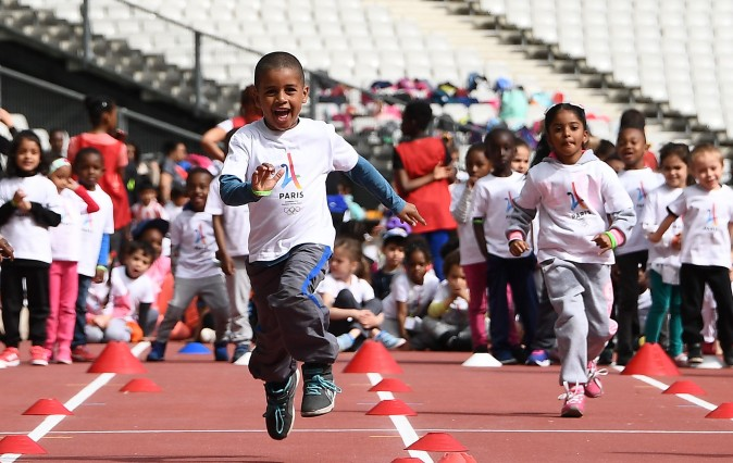 Children run at the Stade de France in Saint-Denis as the IOC Evaluation Commission continues with its visit to Paris, on May 15, 2017, before a vote for the 2024 Summer Olympics. (FRANCK FIFE/AFP/Getty Images)
