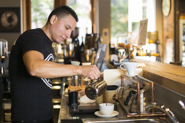 Cesar Jara coffee supervisor at Brazilia Cafe makes coffee using an AeroPress in NoHo Manhattan on Oct. 14 2014