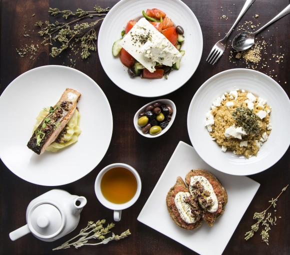 A feast of dishes featuring superfoods from Crete at Loi Estiatorio in Midtown Manhattan. (Samira Bouaou/Epoch Times)