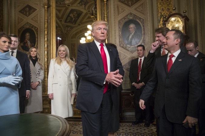 President Donald Trump leaves the President's Room of the Senate on Capitol Hill in Washington on Jan. 20, 2107, after he formally signed his cabinet nominations into law. (AP Photo/J. Scott Applewhite, Pool)