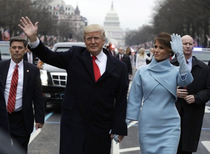 President Donald Trump waves to supporters along the parade route with first lady Melania Trump after being sworn in as the 45th president of the United States in Washington on Jan. 20, 2017. (Evan Vucci - Pool/Getty Images)