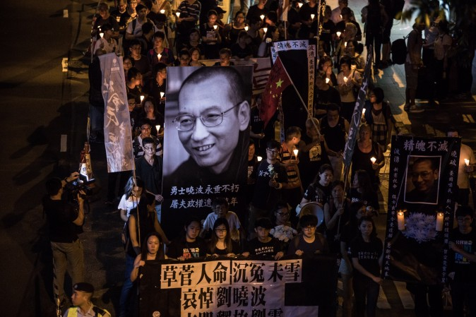 People attend a candlelight march for the late Chinese Nobel laureate Liu Xiaobo in Hong Kong on July 15, 2017. Liu died on July 13 after a battle with cancer, remaining in custody until the end, making him the first Nobel Peace Prize laureate to die in state custody since German pacifist Carl von Ossietzky in 1938. (DALE DE LA REY/AFP/Getty Images)