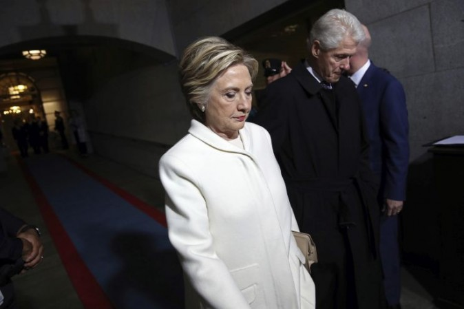 Former Sen. Hillary Clinton and former President Bill Clinton arrive on the West Front of the U.S. Capitol on Friday, Jan. 20, 2017, in Washington, for the inauguration ceremony of Donald J. Trump as the 45th president of the United States. (Win McNamee/Pool Photo via AP)