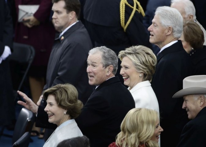 Former President George W. Bush, left, his wife Laura, Former Secretary of State Hillary Clinton and Former President Bill Clinton wait for the 58th Presidential Inauguration for President-elect Donald Trump at the U.S. Capitol in Washington, Friday, Jan. 20, 2017. (AP Photo/Matt Rourke)