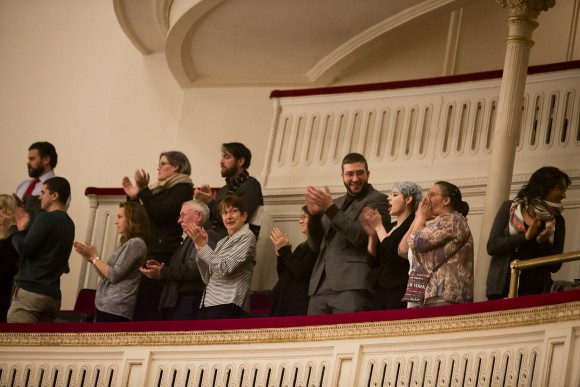 "Audience members give a standing ovation after ""Cantata Memoria"" by Sir Karl Jenkins at Carnegie Hall, conducted by Jonathan Griffiths, in New York City on Jan. 15, 2017. (Samira Bouaou/Epoch Times)"