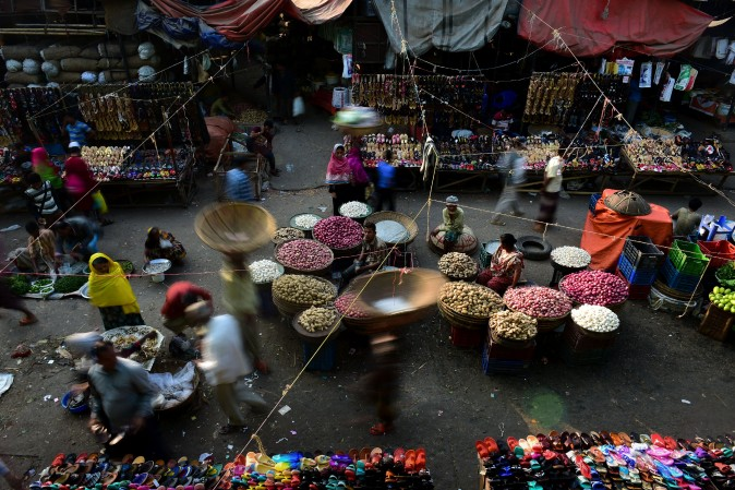Bangladeshi vendors wait for customers at a wholesale market in Dhaka on Jan. 22, 2017. Dhaka Kawran Bazar is a major business district and wholesale market place in Dhaka. (STR/AFP/Getty Images)