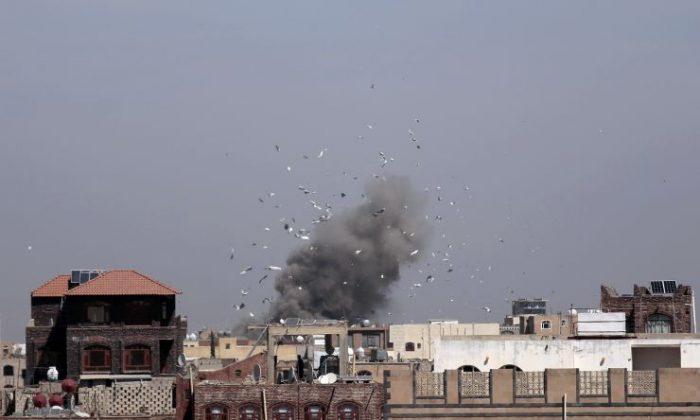 Debris and smoke rise after a Saudi-led airstrike hit an army base, in Sanaa, Yemen, Sunday, Jan. 22, 2017. (AP Photo/Hani Mohammed)