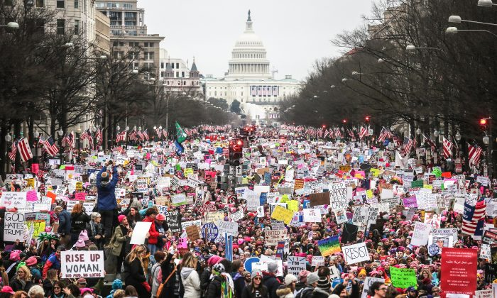 Protesters walk up Pennsylvania Avenue during the Women's March on Washington on Jan. 21. Large crowds are attending the anti-Trump rally a day after U.S. President Donald Trump was sworn in as the 45th U.S. president.  (Mario Tama/Getty Images)